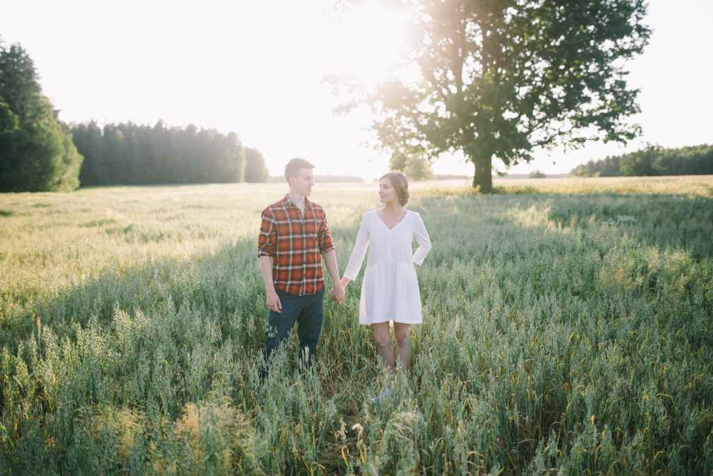 romantic young couple in green field