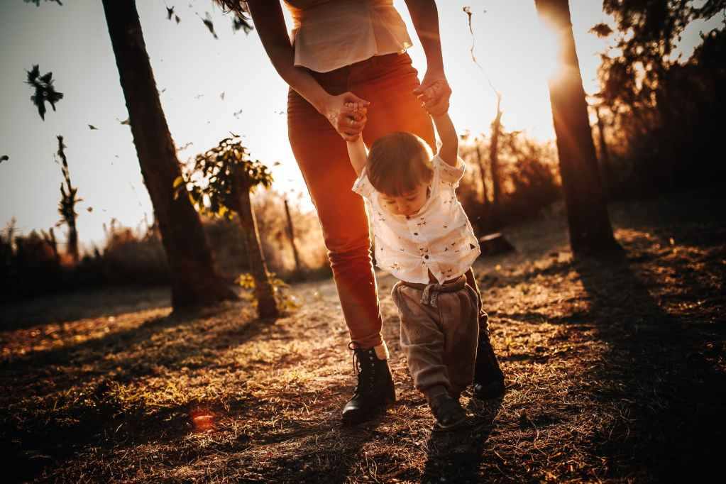 mother with son walking in park