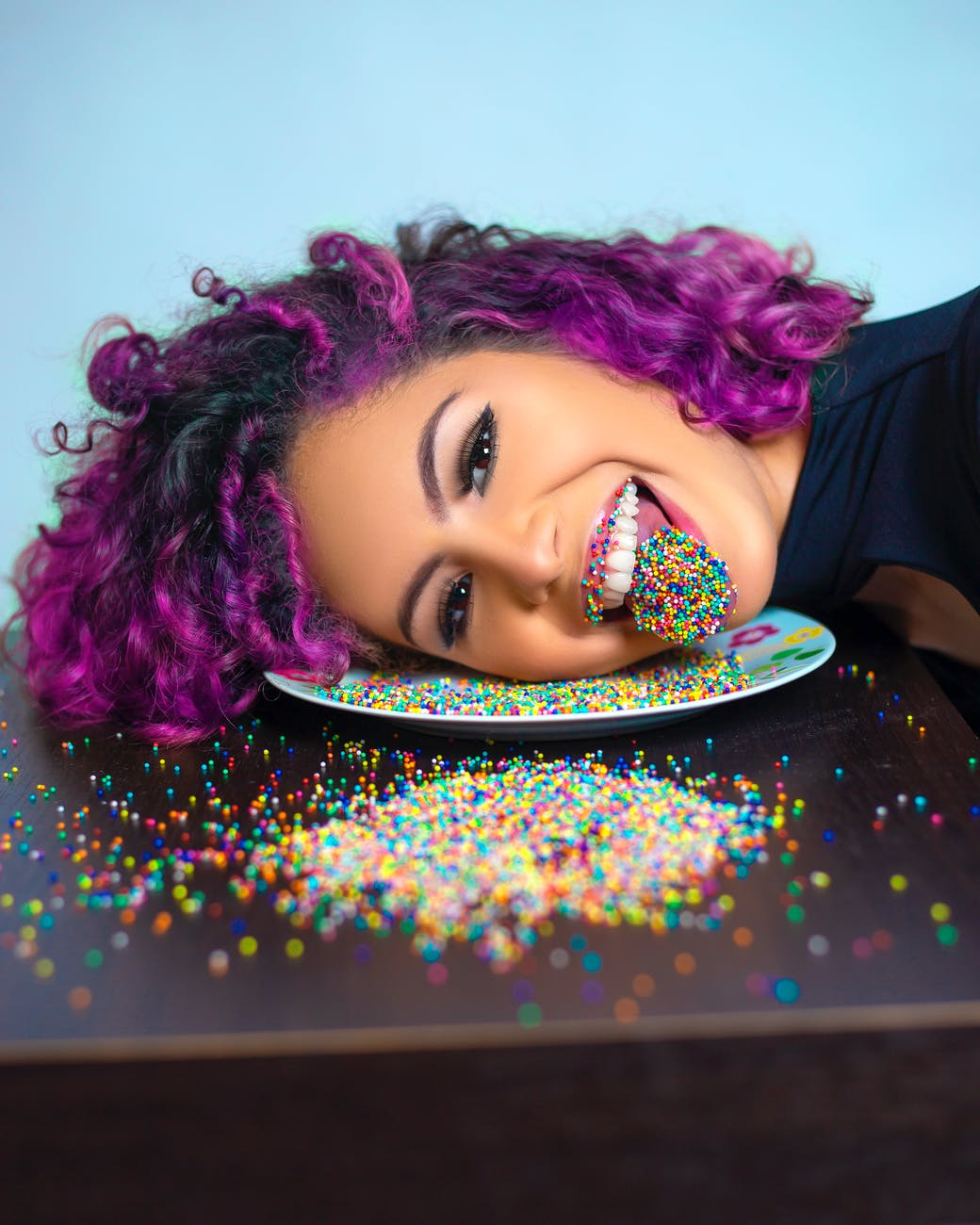 emotional woman with sprinkles on tongue