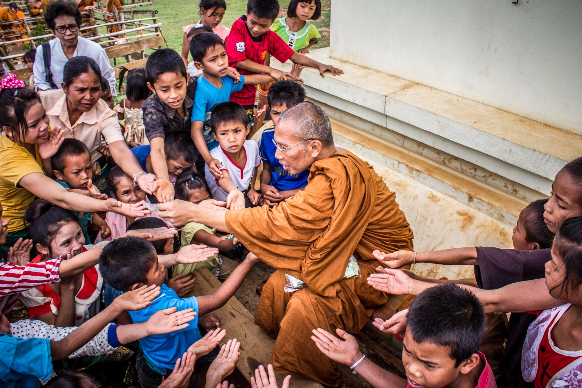 monk surrounded by children